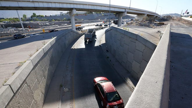 Drivers merge onto I-10 East from Sunland Park Drive Friday in West El Paso. The underpass ramp will permanently close this Sunday as party of the Go 10 project.