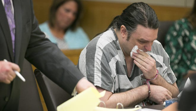 Stephen B. Martin wipes away tears during his sentencing hearing at Maricopa County Superior Court in Phoenix on Friday. Martin convicted in the wrong-way crash on Interstate 17 that killed a Phoenix Fire Department dispatcher.