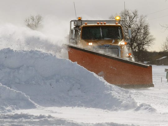 A St. Clair County Road Commission plow works during