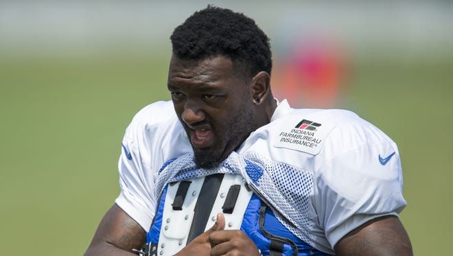 Indianapolis Colts inside linebacker Amarlo Herrera (49) puts on his practice uniform during Colts training camp, Anderson, Saturday, August 8, 2015.