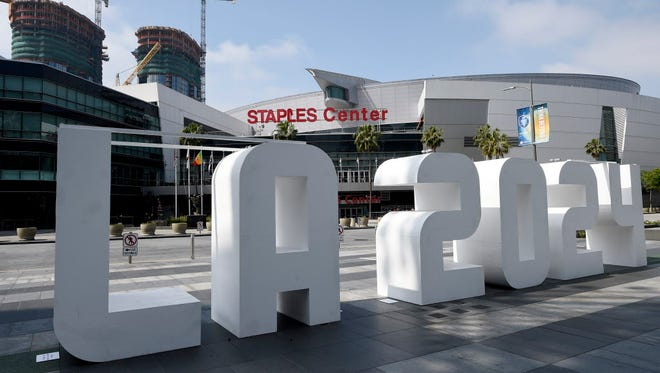 An LA 2024 sign is placed at LA Live in front of Staples Center as the International Olympic Committee Evaluation Commission continues its tour of proposed venues by LA 2024 bidding committee for the Los Angeles 2024 Summer Olympic Games.