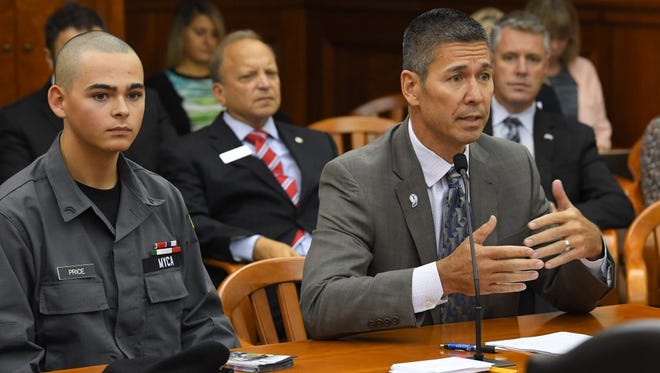 Michigan Youth Challenge Academy Director Jeff Connell, right, and Cadet Dakota Price, speak before a House committee earlier this year. State Rep. John Bizon, R-Battle Creek, sits directly behind them.