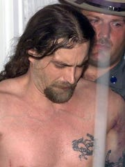 Timothy Vail, then 35, is taken from New York state police barracks in Horseheads, July 8, 2003, back to the Elmira, N.Y. Correctional Facility. State police apprehended Vail and Timothy Morgan, 26, two convicted murderers who escaped from a maximum-security prison by scaling down the side of the building using a rope made from bed sheets, officials said.
