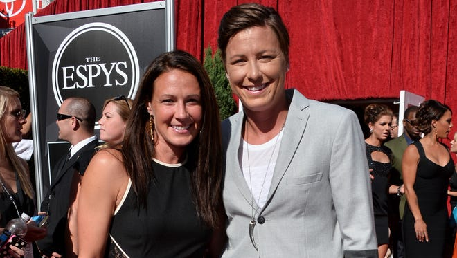 Abby Wambach and Sarah Huffman attend The 2013 ESPY Awards at the Nokia Theatre in Los Angeles.