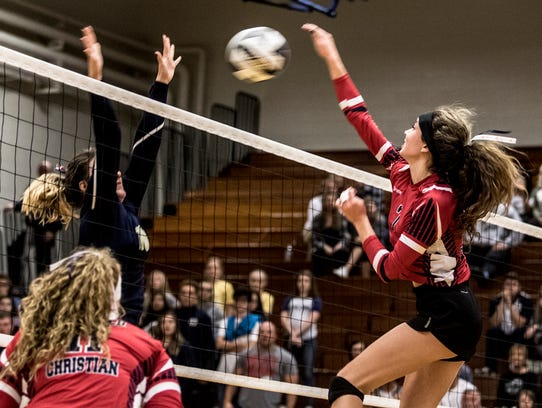 Fairfield Christian Academy's Blaire Barr hits the ball over the net against Portsmouth Notre Dame during the Knights' 3-1 victory in a Division IV regional final.