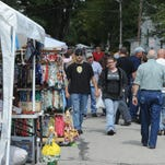 Shoppers walk between rows of vendors during Levi Coffin Days in Fountain City.