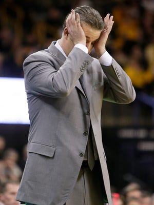Purdue head coach Matt Painter reacts after a pass by Purdue sails out-of-bounds during the second half of their Big Ten Conference NCAA basketball game against Iowa at Carver-Hawkeye Arena, Sunday, March 2, 2014, in Iowa City, Iowa. Iowa won, 83-76. (AP Photo/Jim Slosiarek)