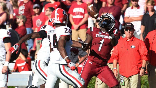 South Carolina wide receiver Deebo Samuel (1) makes a catch as Georgia cornerback Deandre Baker (18) and Dominick Sanders (24) defend during the second half of an NCAA college football game on Sunday, Oct. 9, 2016, in Columbia, S.C. (AP Photo/Rainier Ehrhardt)