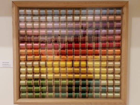 A display of silk threads and colors used in Needlework
