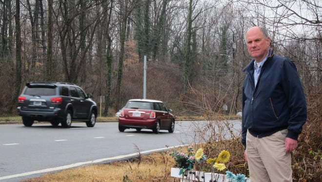 Richard Boltuck, an economist who lives in Bethesda, Maryland, stands near his home at a makeshift memorial for three family members who were killed in February at the accident-prone intersection. Boltuck has been lobbying the state for information about the intersection's dangers for eight years.