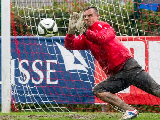 """FILE - In this Oct. 10, 2012 file picture Swiss national soccer goalie Diego Benaglio saves   the ball during a practice session in Jona, Switzerland . Switzerland goalkeeper Diego Benaglio says he is retiring from international football aged 30. Benaglio went to three World Cups and was Switzerland's first-choice 'keeper in 2010 and in Brazil. His 61st and final international was during the 1-0 loss to Argentina in the Round of 16. Wednesday's Aug. 20, 2014 announcement comes days after FIFA's World Cup technical report praised Bengalio among the """"good examples of this new generation of goalkeepers"""" who are skilled with the ball at their feet. (AP Photo/ Keystone/ Alessandro Della Bella, file)"""