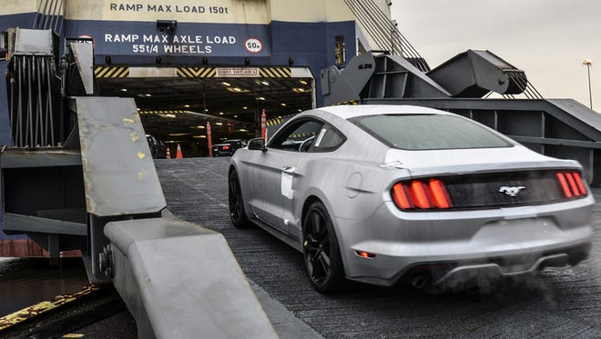 A new Michigan-made Ford Mustang is loaded aboard a ship for export.