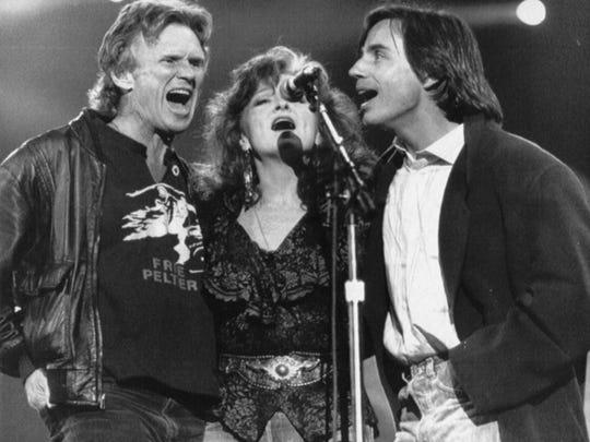 Kris Kristofferson, Bonnie Raitt and Jackson Browne (from left) perform during Farm Aid IV in Indianapolis April 7, 1990.