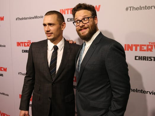 James Franco and Seth Rogen pose for the cameras at