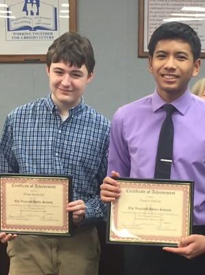 Vineland High School Poetry Out Loud runner-up Jeremy Rasmussen (left) and winner Francis Virtucio were honored by the Vineland school board Feb.  14, 2018.