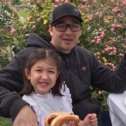 Father holding his daughter in his lap fatally stabbed while dining at restaurant in California