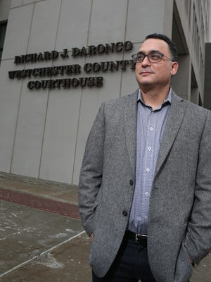 """Michael Katz, a White Plains blogger who is a vocal critic of Family Court practices, stands outside the Westchester County Courthouse. """"There is no easier way to get tax dollars,"""" he says of the law guardian system."""