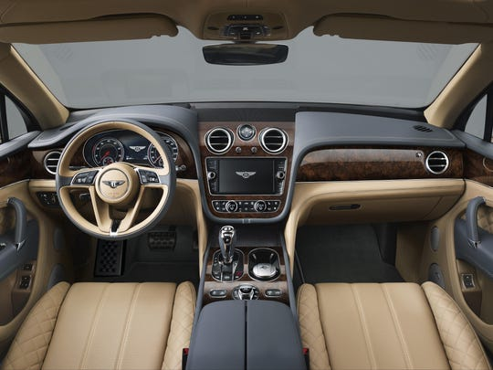 Intricate detailing and precision in wood, metal and leather creates a modern, luxurious handcrafted interior.