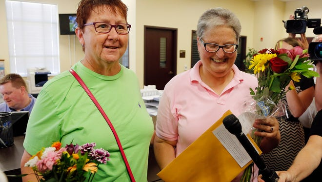 April Miller, right, and Karen Roberts exit the Clerk's office after obtaining their marriage license at the Rowan County Courthouse in Morehead, Ky. Sept. 4, 2015