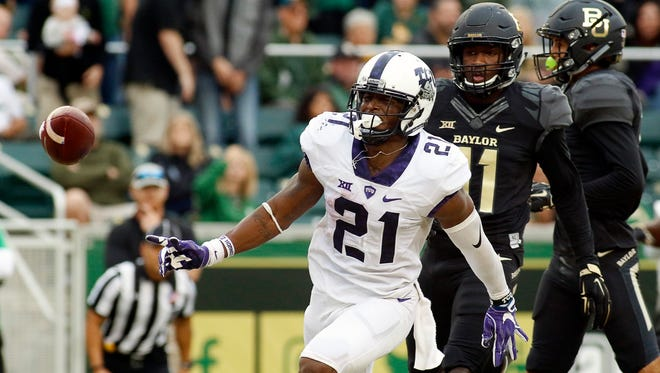 TCU Horned Frogs running back Kyle Hicks (21) celebrates his 22-yard touchdown run against the Baylor Bears during the first half at McLane Stadium.