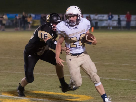 Sycamore's Michael Loosli runs the ball during the