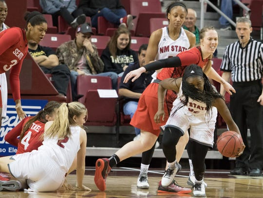 New Mexico State guard Moriah Mack comes up with the
