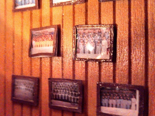 Miniature framed photos of her father's church choirs