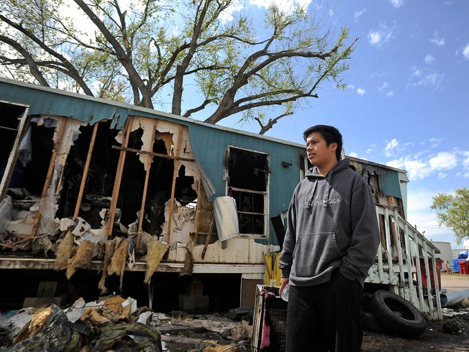 Gustova Pena talks about how his family has lost everything in a mobile home fire in Sioux Falls, S.D. Tuesday, May 20, 2014.