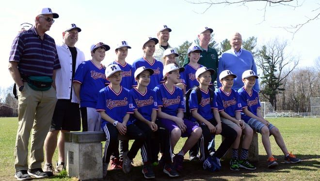 Sen. Patrick Leahy, right top row, poses for a picture with a youth baseball team heading to Cuba on Sunday.