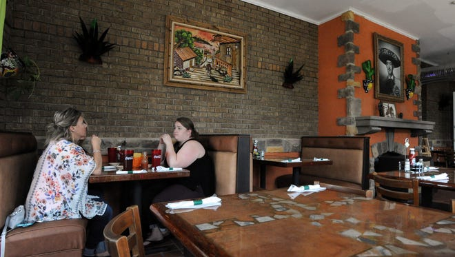 Angie Eisenacher, left, and Rachel McAnespie, right, eat lunch with Debbie Taylor, not pictured), Thursday, May 10, 2018, at Maria's Mexican Restaurant in downtown Lancaster.