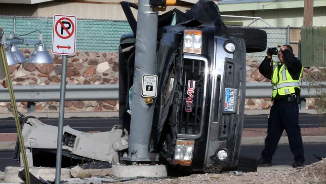 El Paso police traffic investigators work a fatal accident involving two vehicles Friday morning at the intersection of Lee Treviño Drive at Castner Drive.