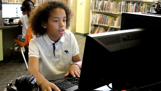 Davire Wood, 10, from York City, plays games on the computers at Martin Library, Friday, July 22, 2016.  Comcast has announced the expansion of the Internet Essentials program, which offers high-speed internet to low-income families.  John A. Pavoncello photo
