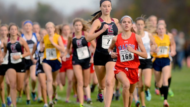 Cecilia Stalzer pulls away from the pack in the early going of the girls TDivision 2 regional cross country meet at Uncle John's Cider Mill Friday, October 28, 2016, in St. Johns.
