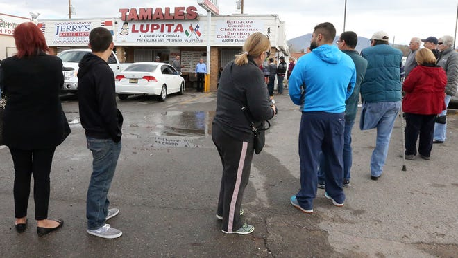 """Patrons eager for tamales line up outside Tamales Lupita at 6860 Doniphan in Canutillo Friday morning. Owner Mundo Carrillo said the Christmas holiday tamales business """"Gets better each year thanks to the people."""" Carrillo has operated the business for 33 years. Last year he sold between 15,000 to 18,000 dozen tamales in the month of December."""