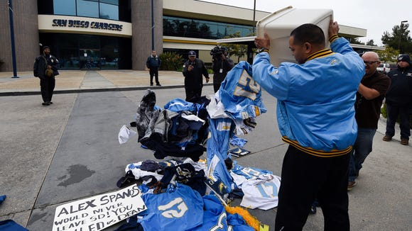 120b345b Fans dump now-unwanted Chargers gear at team facility