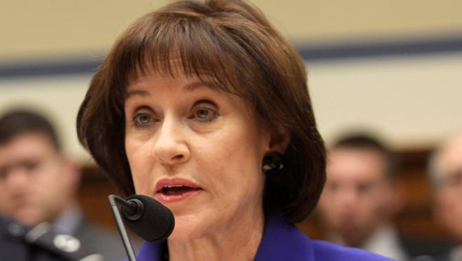 In this March 5, 2014, file photo, former Internal Revenue Service official Lois Lerner is seen on Capitol Hill in Washington.  Lerner and Holly Paz have argued in recent court filings that the threat to their lives outweighs the public's right to hear their testimony about how IRS employees handled applications for tax-exempt status from tea party groups.