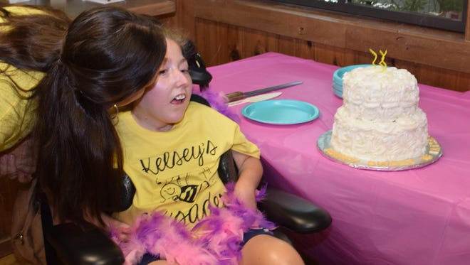 """Jessica Desselle kisses daughter Kelsey Deselle after everyone sang """"Happy Birthday."""""""