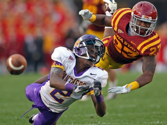 The ball bounces away from UNI's Terrell Sinkfield as pass interference was called Iowa State's Leonard Johnson during a 2011 game.