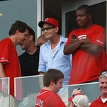 Josh Hutcherson throws out the first pitch to Cincinnati Reds Brandon Phillips (4) during pre-game on April 7, 2012.