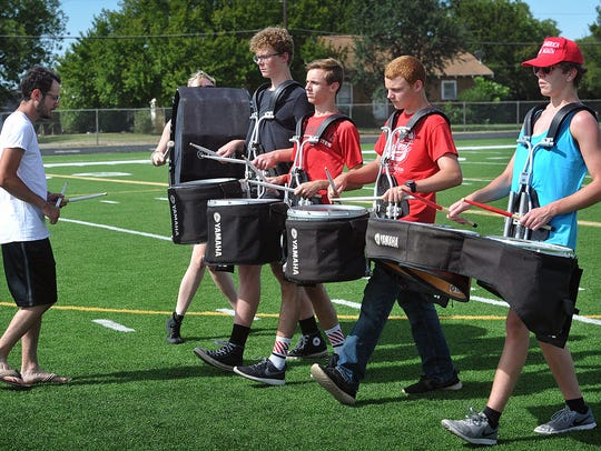 Brian Zug, left, drum tech for the Wichita Falls High