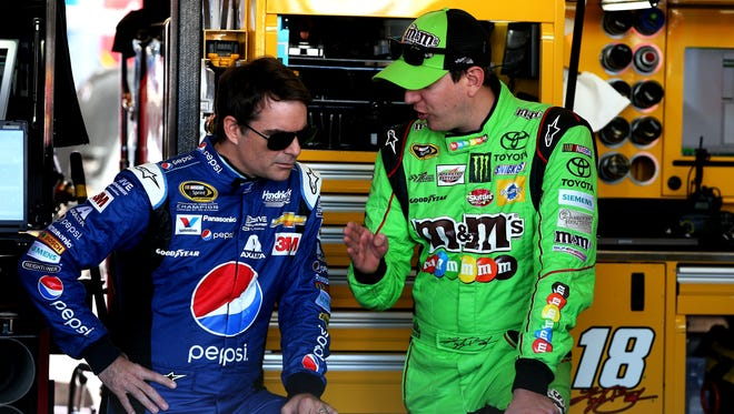 Jeff Gordon, left, and Kyle Busch, will compete for the 2015 Sprint Cup Series championship along with Kevin Harvick and Martin Truex Jr. (not pictured).