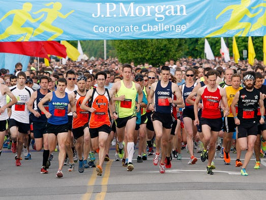 Runners hit the course during the Corporate Challenge at RIT in Henrietta Thursday evening.