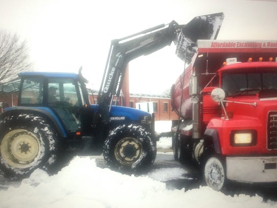 City crews prepare to haul snow away recently after