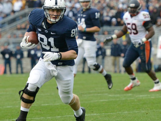 FILE - In this Nov. 2, 2013, file photo, Penn State tight end Adam Breneman (81) carries the ball in the fourth quarter of an NCAA college football game against Illinois in State College, Pa. After what turned out to be a brief but much-needed sabbatical from football, Breneman has his life in order. (AP Photo/John Beale, File)