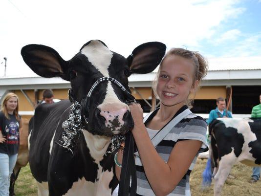 ARM Dodge County Fair girl and cow 2012.jpg