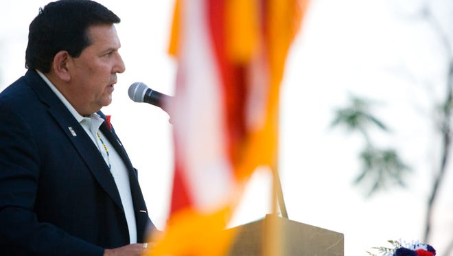 Former Director of the Arizona Department of Veteran Services Col. Joey Strickland speaks during a Memorial Day Service in 2009.