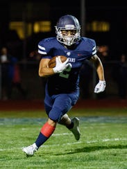 Brookfield East senior Justin Parbs (2) races for the
