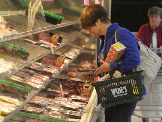 Olga Winkler of Victor looks over the meat products.