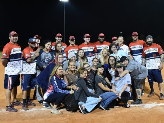 Warriors pose with Justin's Place Girls Group during the battle between The Louisville Slugger Warriors and Team Florida.