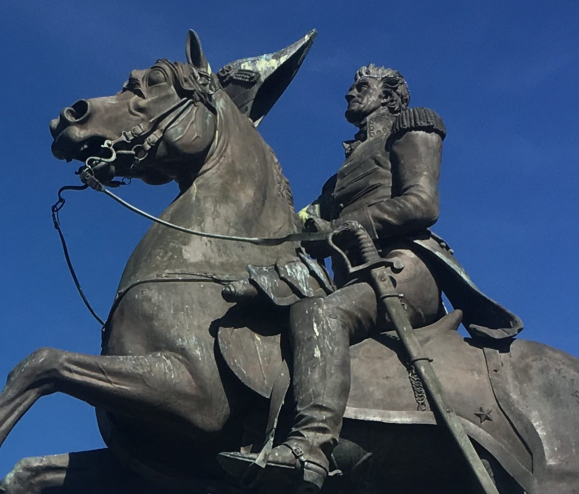 The statue of Andrew Jackson, hero of the Battle of New Orleans, atop of his horse in Jackson Square with St. Louis Cathedral in the background.